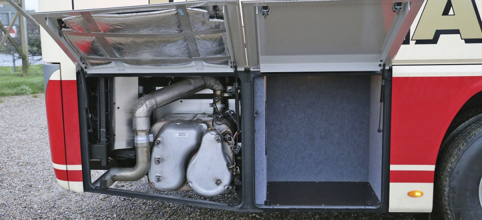 On the left the emissions equipment and to the right a driver's locker at the offside rear