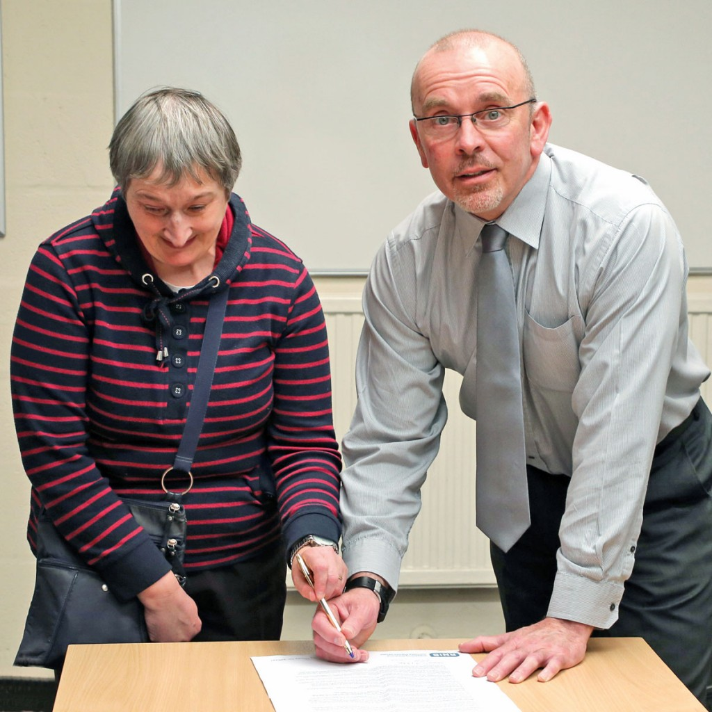Bus Passenger Champion for Birmingham, Sharon Gibbs, and National Express West Midlands Head of Training and Recruitment, Mark Simcox, sign the Bus Charter