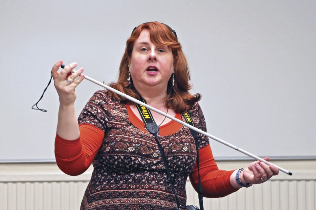 Natalie Doig, RNIB National Campaign Officer, demonstrates a symbol cane