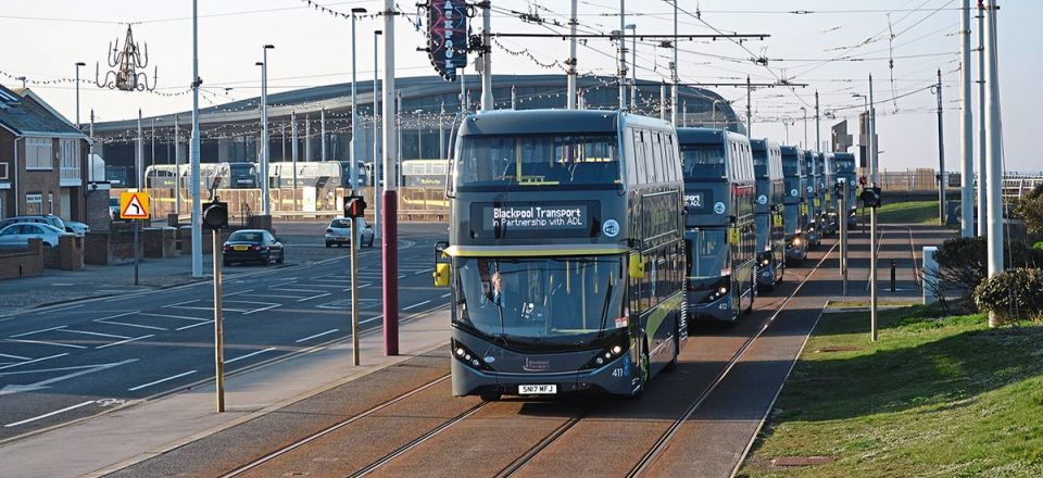 The parade of 25 Enviro400 City Palladiums leaving BTS's Starr Gate tram depot
