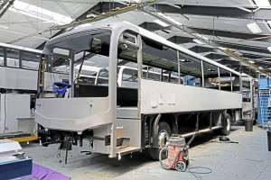 On the assembly lines-A Leopard showing the extruded fibreglass side panel and an Enviro200 with the roof window option-1