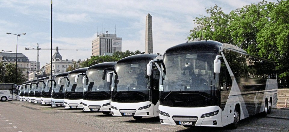 Ten new generation Neoplan Tourliners were lined up outside the Palace of Culture in Warsaw to provide a 'ride & drive' experience for journalists on the return three-hour journey to the plant at Starachowice