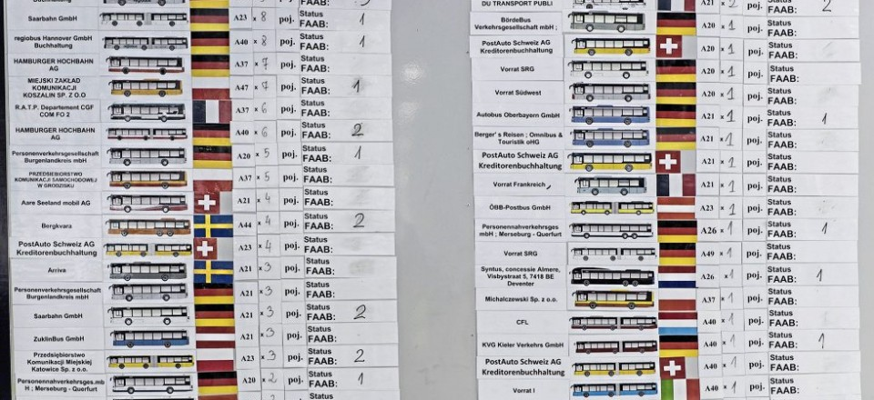 This board in the plant showing complete buses in build demonstrates the wide variety of customers and variants offered. Models A20, A21, A23, A26, A37, A40, A44, A47 and A49 are mentioned and there were also chassis such as the A22 in production