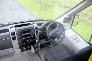 The cab is essentially Mercedes-Benz Sprinter. Note the neat Mellor control panel to the driver's right for the body systems and the rear view camera screen