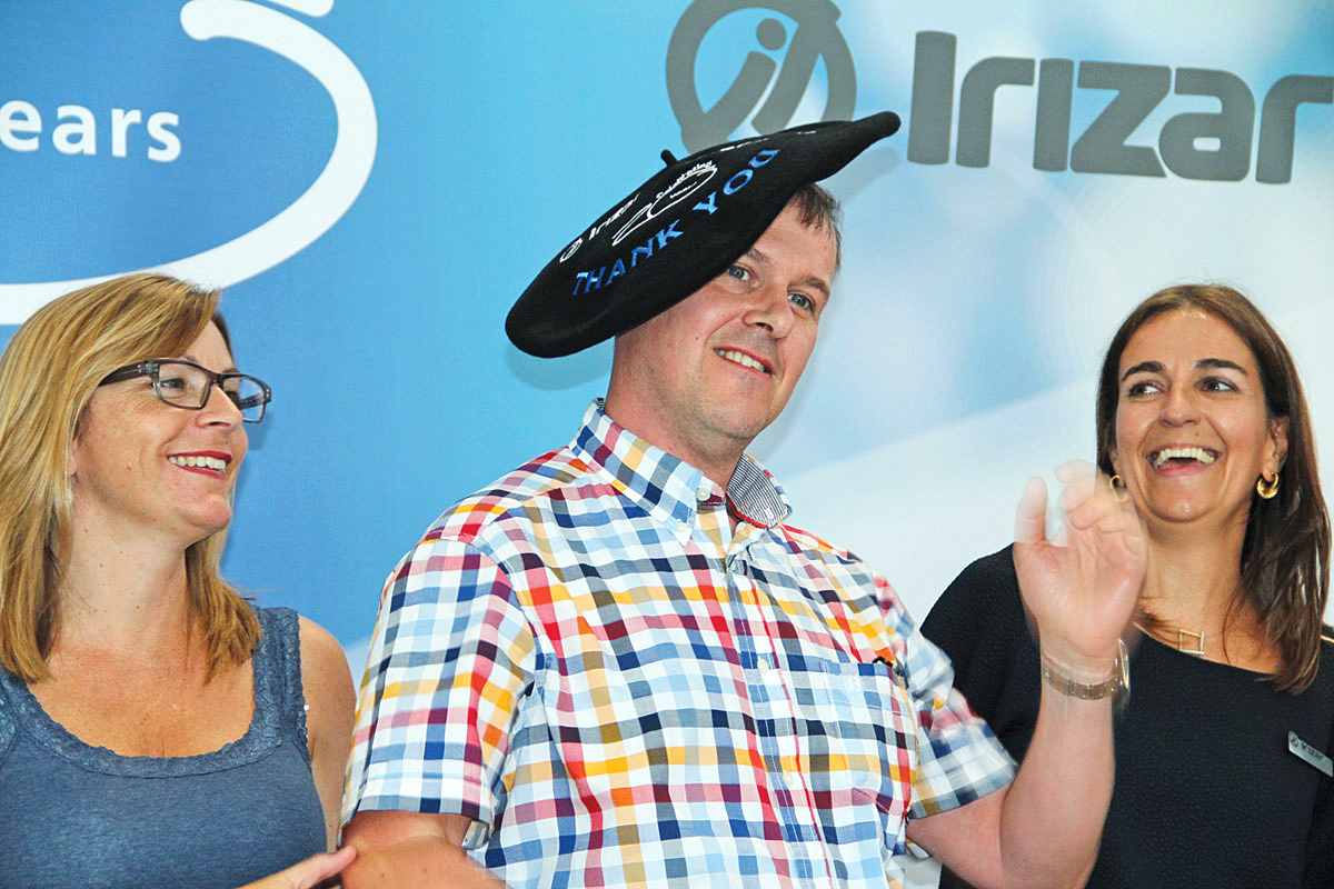 John Shaw sports the celebratory txapela (beret) presented to him by Irizar. He purchased the first Scania Irizar in the UK and has continued to buy Irizars regularly ever since.
