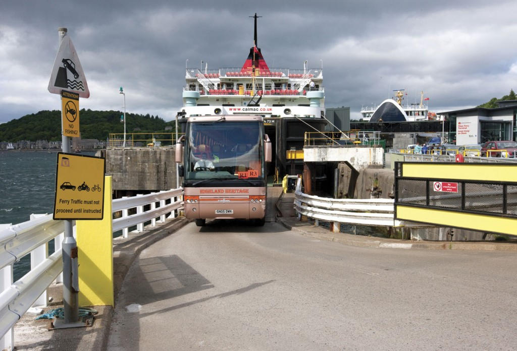 A Highland Heritage Van Hool comes off a CalMac ferry. They carry 11,500 coaches a year! (Pic:Dennis Hardley).