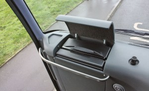 A useful fridge is incorporated into the dash.