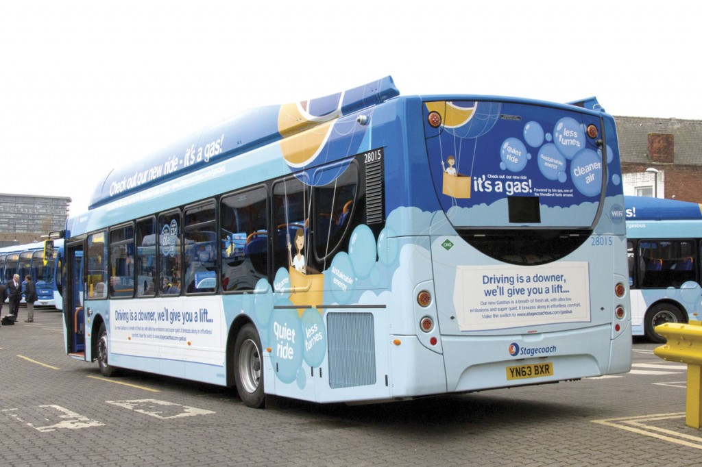 The rear of the Scania ADL Enviro 300 carries messages promoting the benefits of gas power