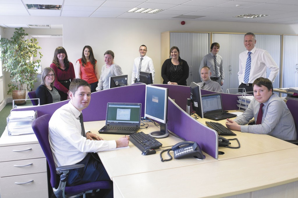 Members of the EPM team gather in one of the bright open plan office spaces