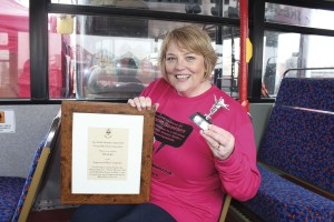 Michelle Hargreaves, Stagecoach East Midlands MD, with the mounted scroll and statue she was presented with by the Lord Mayor