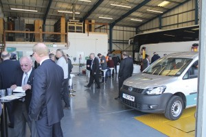 Visitors chat with members of the Arriva team in the workshop facility