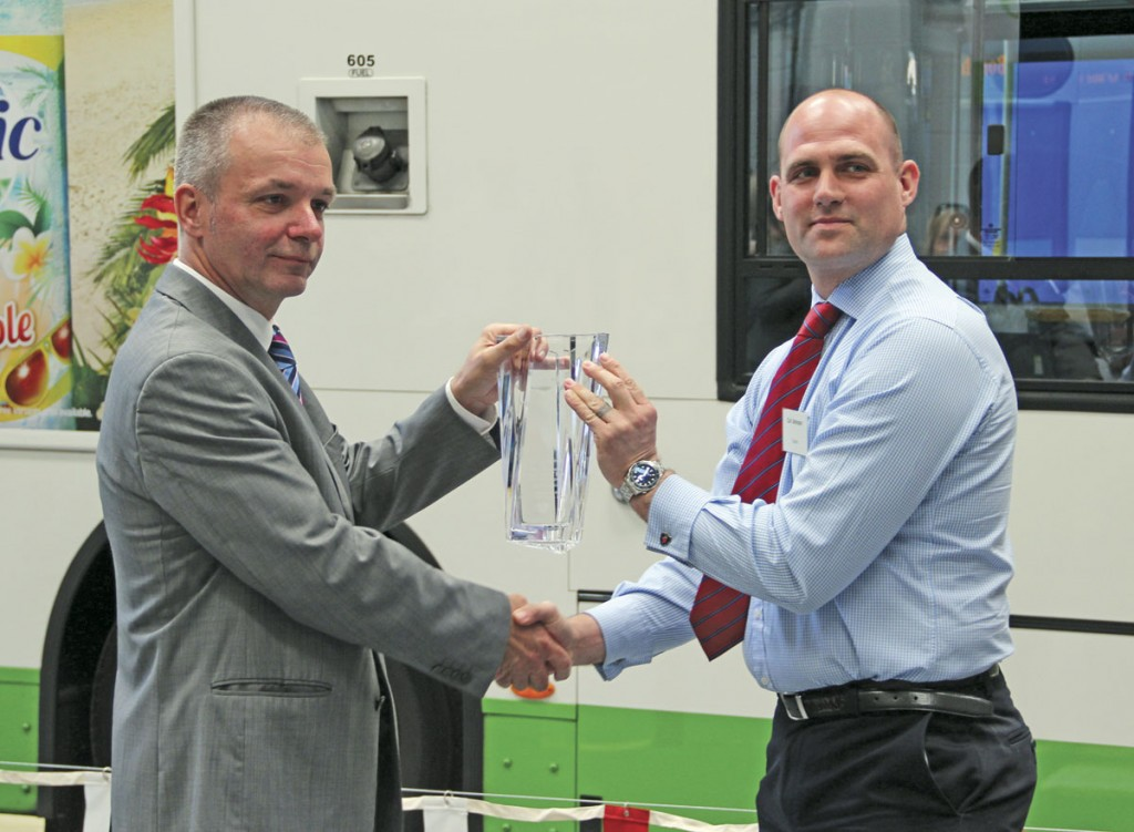 Bill Hiron receives an engraved glass vase from Carl Johnson of Scania