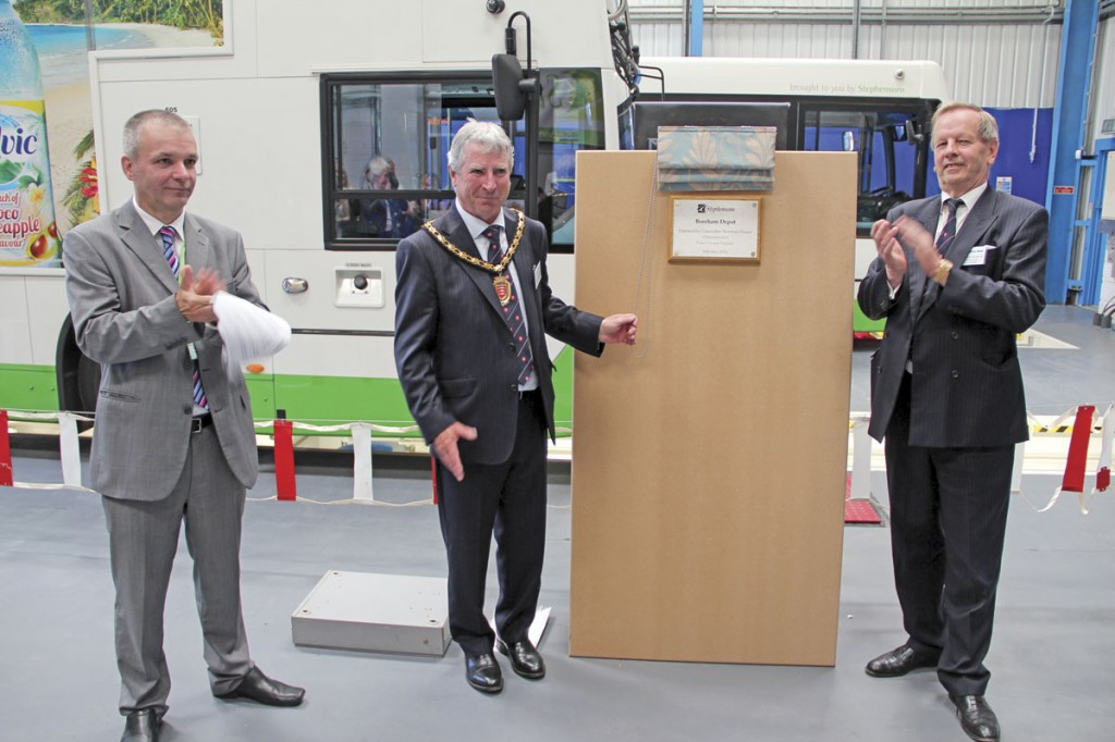 Stephensons MD, Bill Hiron (left) and Cllr Rodney Bass (right) applaud as Essex County Council Chairman Elect, Norman Hume, unveils a celebratory plaque