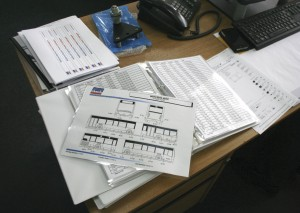 A huge array of schematics is kept, listing various vehicles' entire part inventories with numbers to aid in picking the correct component first time