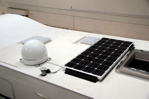 A solar panel and a satellite dome installed on the roof of the motorhome demonstrator