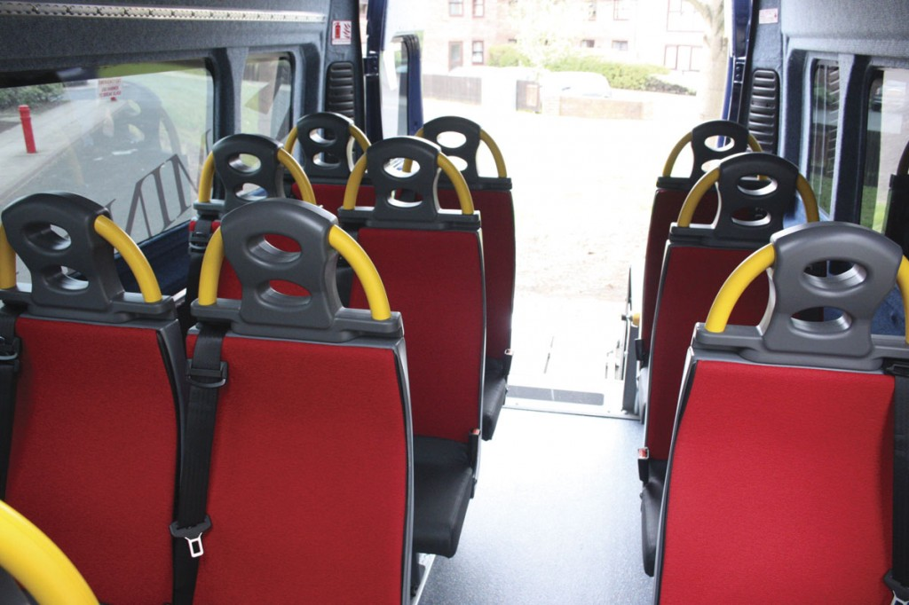 The interior of the Minibus Options Fiat Ducato conversion with seating for 12