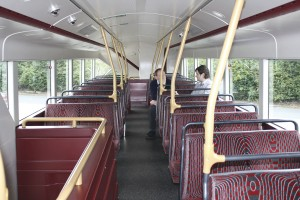 Local council member and a First representative in discussion on the top deck of the bus