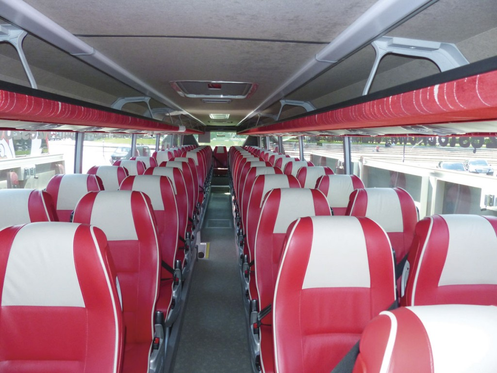 The PolskiBus.com red and cream colours are echoed throughout the bespoke interior and the piped leather seats add a luxurious feel