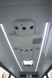 The ceiling carries full length lighting, speakers, Mercedes-Benz air conditioning unit and glazed roof hatch