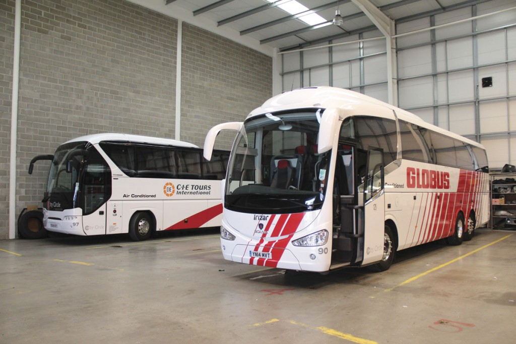 The tri-axle K410EB 6x2 Irizar i6 in the depot with a 2014 Neoplan Tourliner tri-axle behind