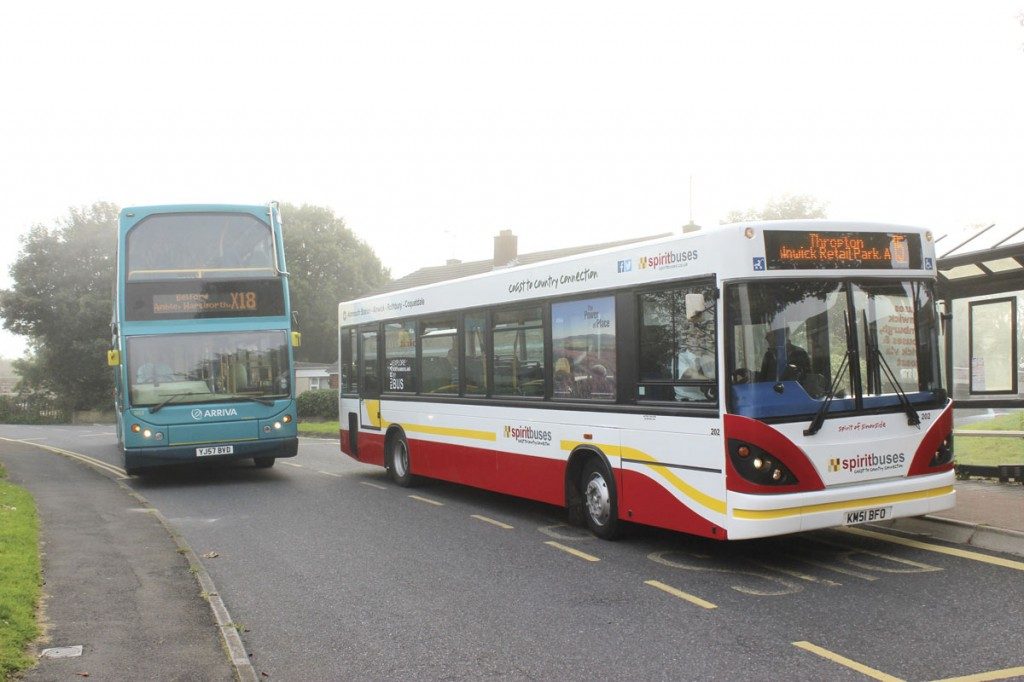 An Arriva service passes the Spirit Buses service at Alnmouth. Steve does not want to abstract custom from Arriva, he hopes passengers that travel on Arriva's buses will travel on the connections he is providing