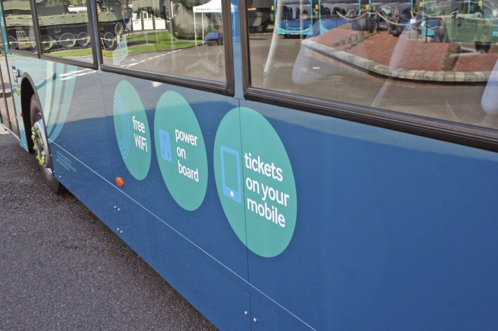 The buses' livery promotes the facilities available onboard