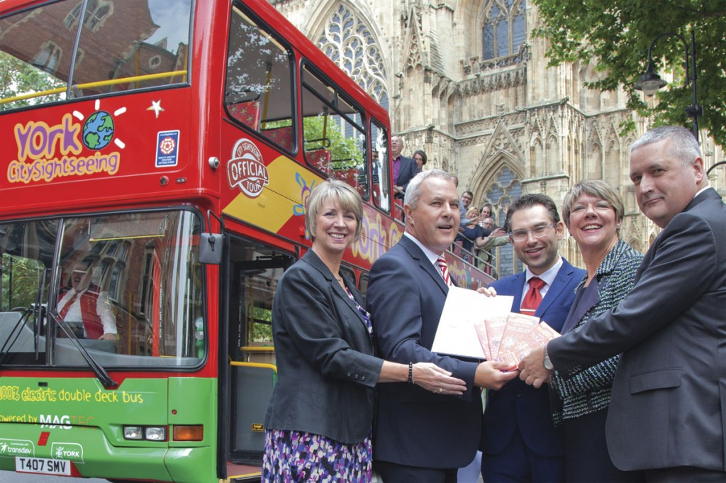 The formal launch outside the Minster with (LtoR) Mandy Gaughan (City Sightseeing), Jim Wallace (Transdev), Cllr James Alexander (Leader of City of York Council), Jane Lady Gibson (Chairman of Visit York) and Marcus Jenkins (Magtec)