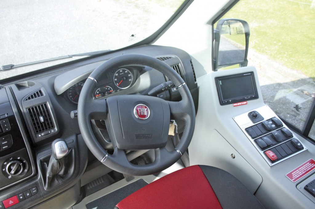 The main dash area and controls are Fiat Ducato and very well laid out. To the right of the driver a neatly moulded unit carries body control switches, reversing camera screen and lockable storage for the driver
