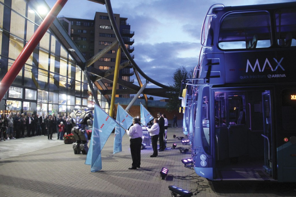 As dusk descends over Newcastle, Titan the robot introduces the floodlit MAX buses