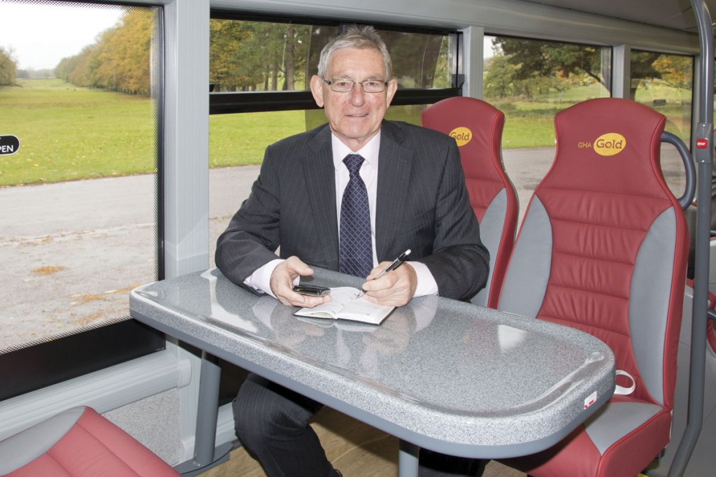 Councillor Rod Menlove demonstrates the workspace provided at the rear of the GHA Gold vehicles