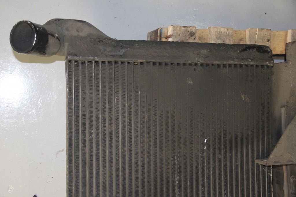 This heat exchanger removed from a bus shows how conventional hydraulic fan systems can become clogged, as well as how easily damaged the protruding fins are
