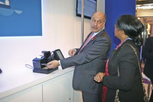 Ticketer's Jon Clarfelt demonstrates his company's mobile ticketing system to Cardiff Bus MD, Cynthia Ogbonna