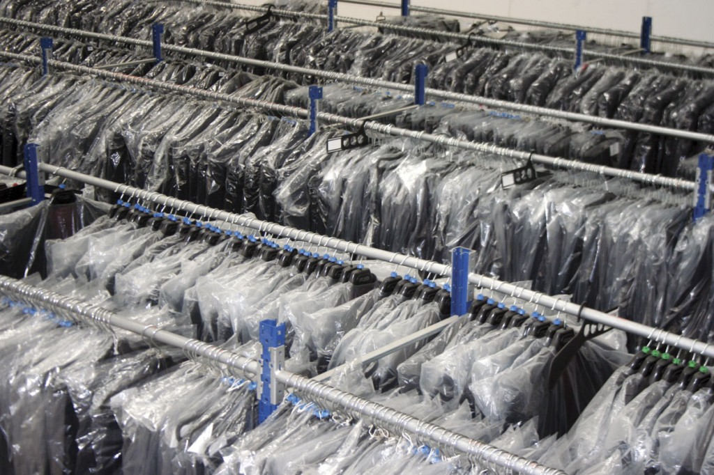 Row upon row of uniforms in store at the business's headquarters