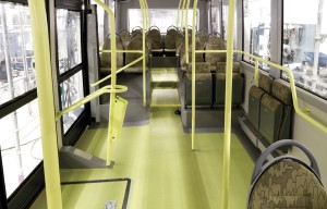 The interior of the full electric bus for Gothenburg from the front showing the locking tip-up seats and steps at the rear