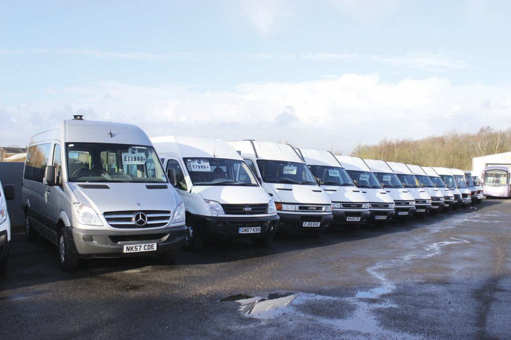 Higher capacity vehicles line the left of the yard with Mercedes-Benz, Iveco and LDV minibuses in evidence