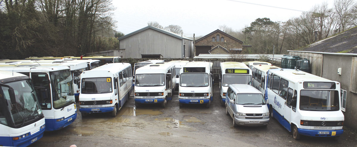 School bus fleet along with one of the feeder minibuses prior to the afternoon school run exodus