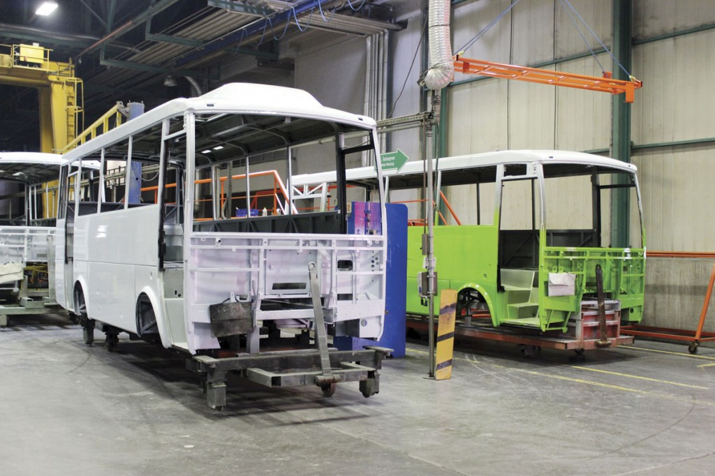 Painted Navigo bodies. Most vehicles are painted white. The green one is for a local municipality