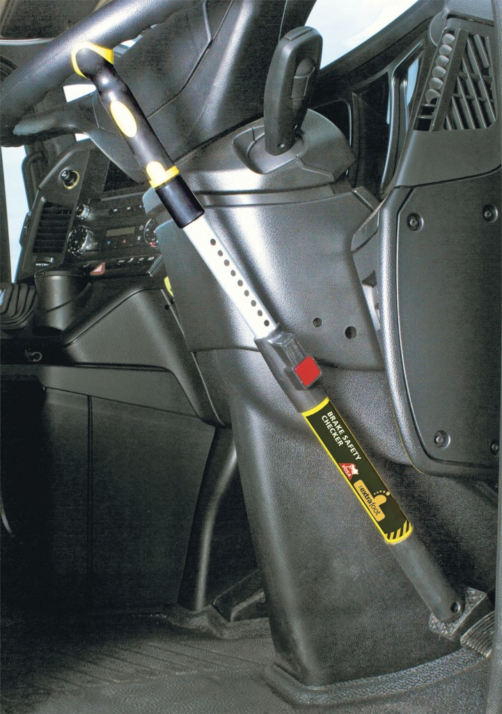The Extra Foot is installed in the driver's cab, clipping to the steering wheel and pressed down on the brake pedal