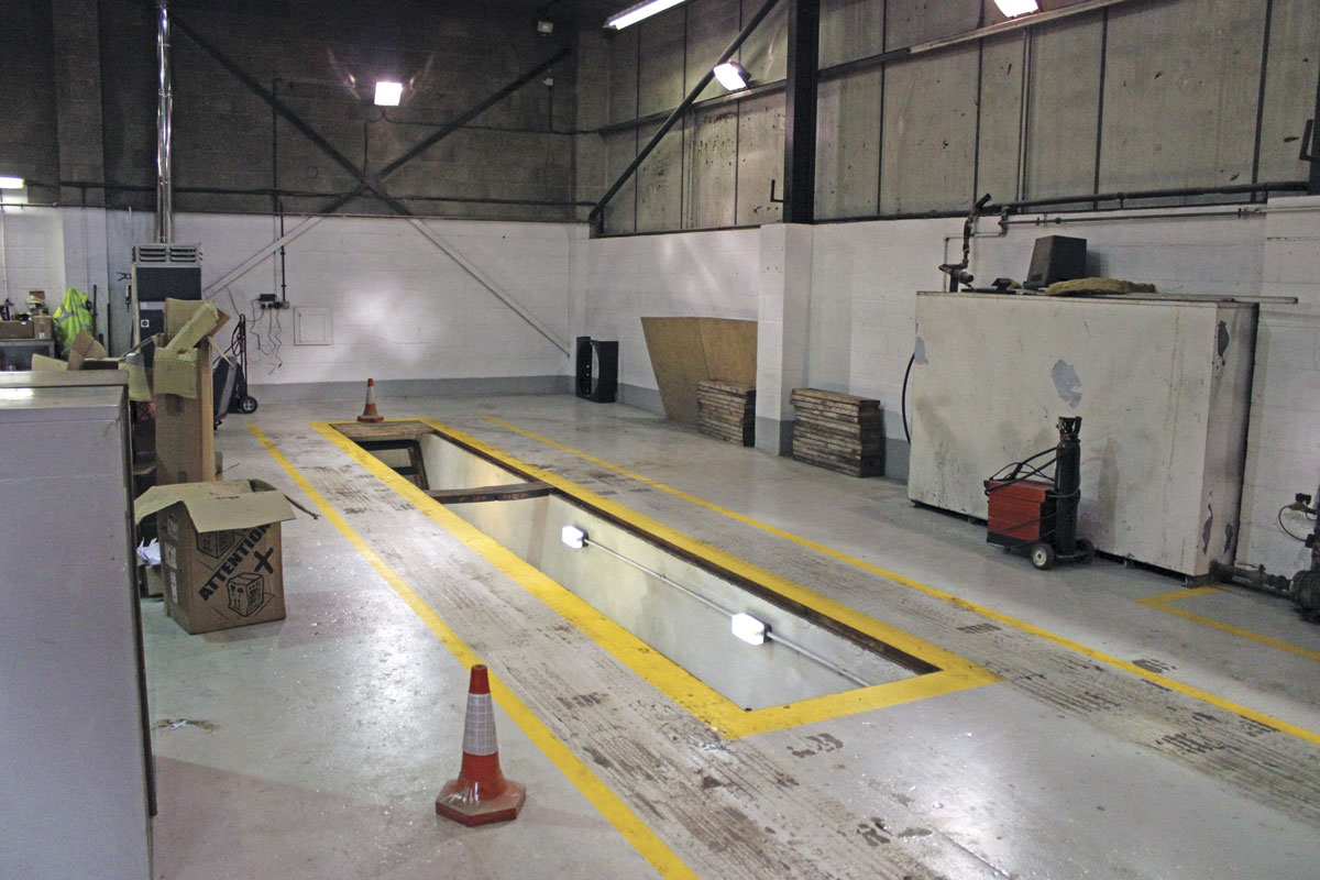 The workshop has a pit in one of the two bays