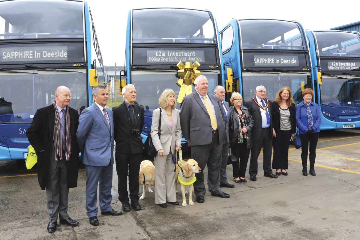 Arriva Buses Wales MD, Michael Morton, (centre under the gold bow) officially launches the new fleet with guests and senior managers
