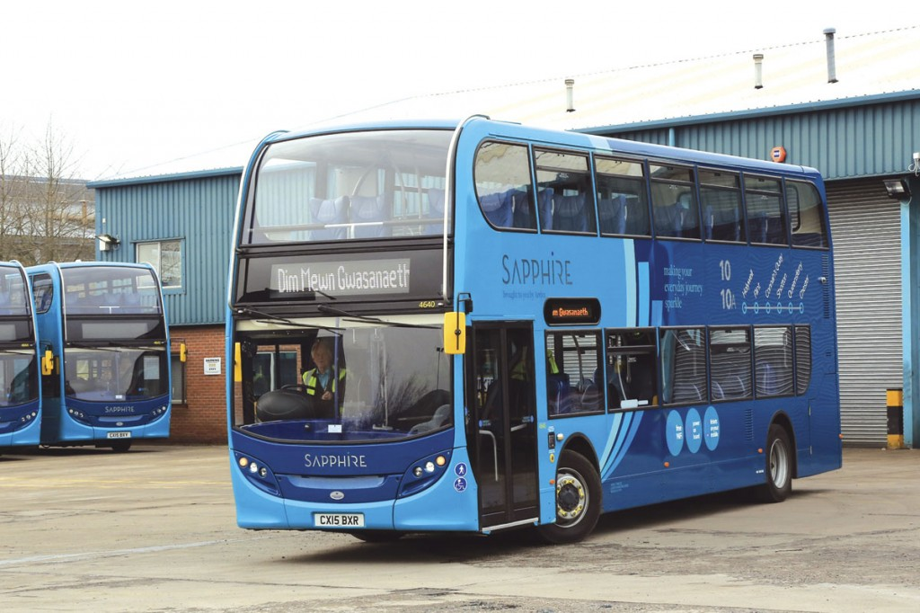 Showing English branding on its nearside and Welsh 'not in service' on the destination display, one of the Enviro400s departs on a driver familiarisation run.