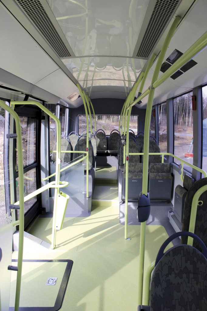 The interior of the bus from the front of the saloon