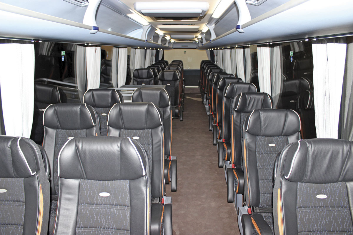 A left hand drive Tourliner 2+1 interior featuring 33 seats