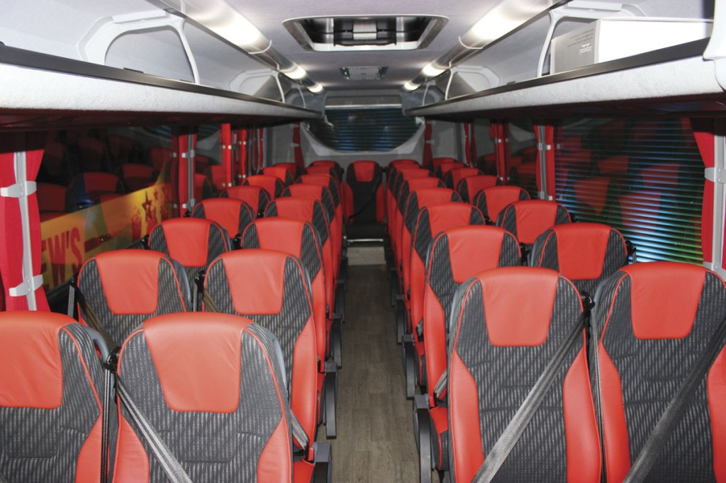 Andrews of Tideswell's 36-seat Cheetah XL interior. The racks are standard Plaxton units