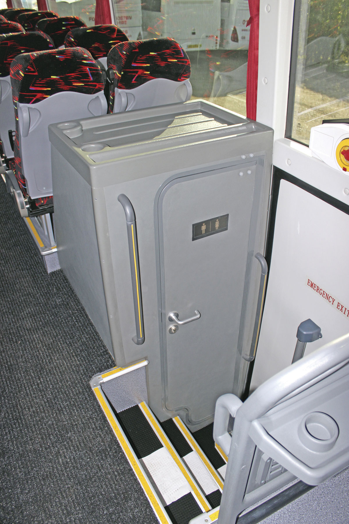 The centre continental door and toilet compartment is mounted two double seats nearer the rear of the coach