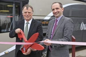 The ceremonial ribbon is cut by (LtoR) Oxford East MP Andrew Smith and Oxford Bus Company MD Phil Southall