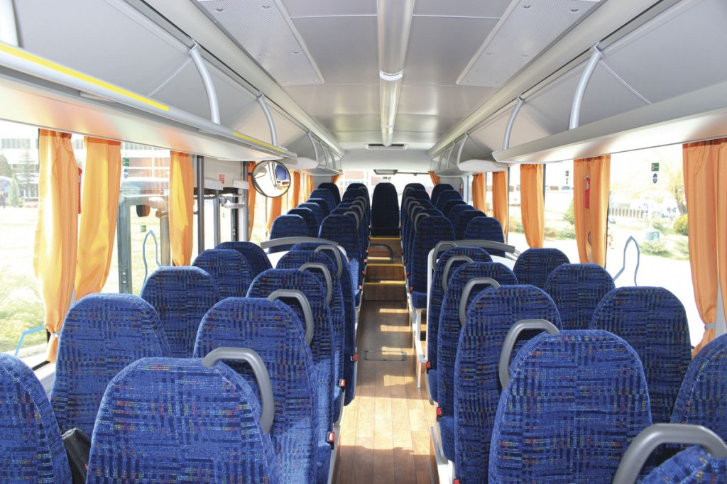 The interior of the 12.3m Intercity. The third example built, it had served six months with a German operator on field trials and has the optional racks. The wood effect flooring is not a production option