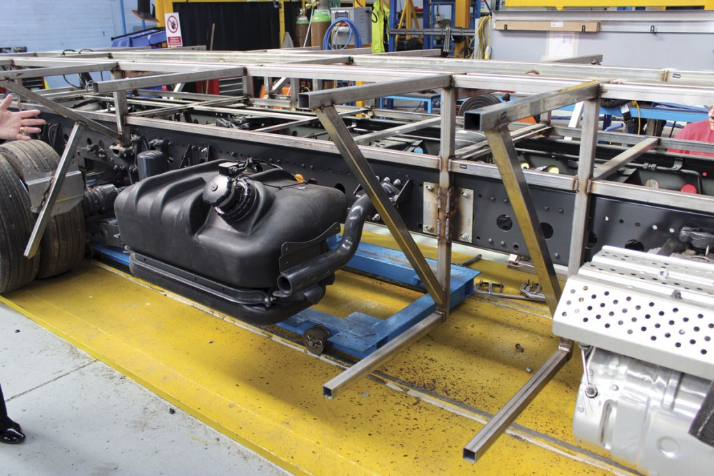 This picture of the chassis in build shows how the fuel tank is relocated to the offside and also how the floor framing is raised above the chassis to create a full length storage area beneath the aisle
