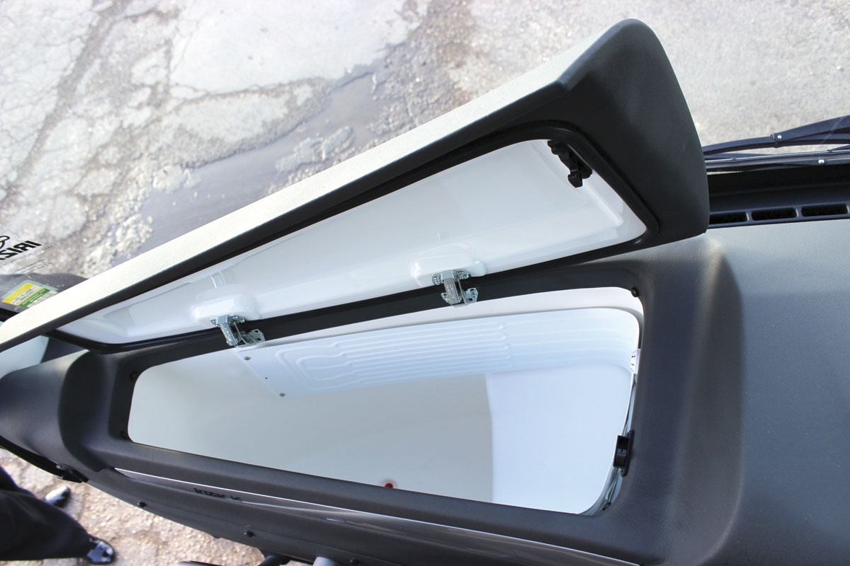 A top loading fridge is mounted within the front dash