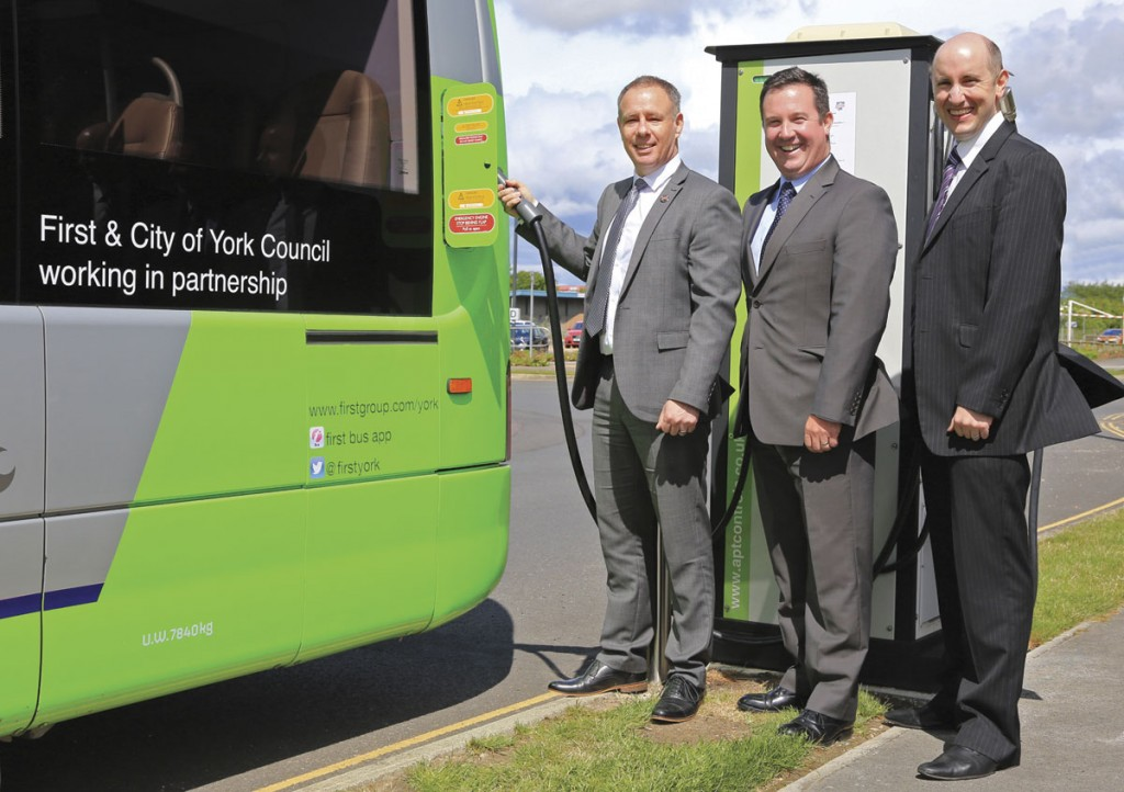 (LtoR) Will Pearson, Business Manager First Bus; Tim Matthews, Head of Sales, Optare and Andrew Bradley, Sustainable Transport Manager at City of York Council connect one of the Versa EVs to the charging point at Monks Cross